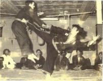 Matthew-Kim-kicking-Daniel-Marie-1982